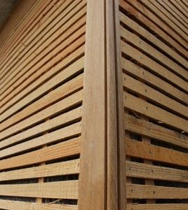 Angle of a wall clad in wooden laths