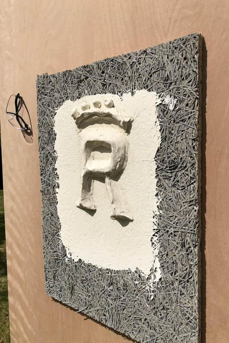Pargetted royal emblem in lime plaster